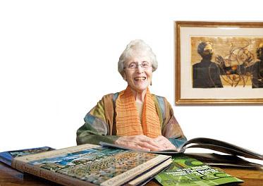A photo of Nina Gibans at her desk